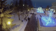 Adornments blink in park near Glory Square at winter evening. - stock footage