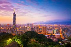 Stock Photo of taipei's city skyline at sunset with the famous taipei 101