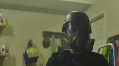 Police swat guy gas mask Stock Footage