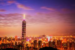 Stock Photo of taipei's city skyline at sunset with the famous taipei 101