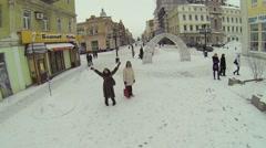 Woman waves hands on street Leningradskaya between buildings Stock Footage