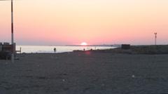 Sunset in Ostia beach Italy Stock Footage