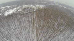 Snowbound park with houses among trees at city outskirts Stock Footage