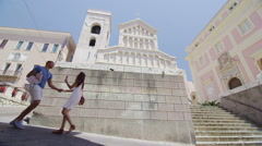 Attractive couple sightseeing and having fun in city - stock footage