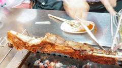4k Ultra HD time lapse video on eating grilled lamb leg (TL-LAMB ROASTING 2-V2) Stock Footage