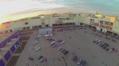Cars drive by parking near shopping center Golden Babylon Stock Footage
