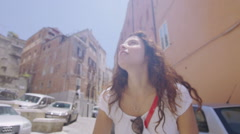 Happy attractive woman on bicycle in the city in summertime - stock footage