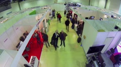 People visit stands during Video Equipment exhibition Stock Footage