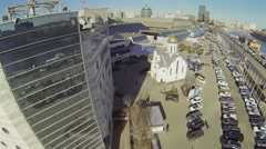 Car parking and church near Expo Center exhibition complex Stock Footage