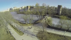 Quay and bridge over icy pond with Novodevichiy Monastery Stock Footage