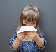 funny little girl holding a chocolate - stock photo