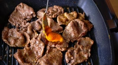 Cheese Sauce Being Added to Appetizing Roasted Slices of Beef on the Pan. Close Stock Footage