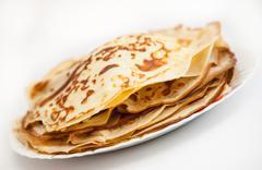 Pancakes on a plate, white background Stock Photos