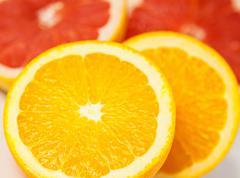 Cutting citrus fruits Stock Photos