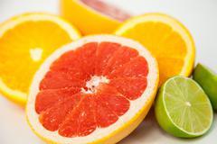 cutting citrus fruits - stock photo