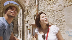 Attractive couple with bicycles, sightseeing and having fun in city Stock Footage