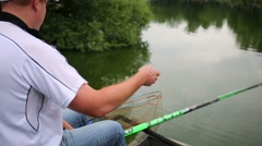 Back view fisherman with long rod and other equipment Stock Footage