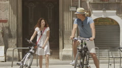 Attractive couple with bicycles, sightseeing and having fun in city - stock footage