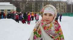 Little girl in beautiful national shawl celebrates Shrovetide Stock Footage