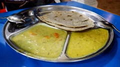 4k Ultra HD time lapse video on eating Chapatti with curry sauce.(TLINDIANFOOD1) Stock Footage