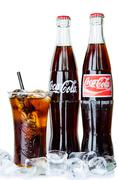 Bangkok, thailand - july 14, 2014: cold classic coke botte on a white backgro Stock Photos