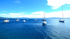 Sailboats Anchored in Deep Blue Lake Tahoe Stock Footage