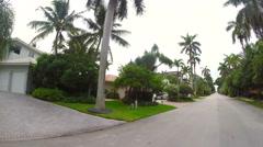 Speeding through a residential neighborhood Stock Footage