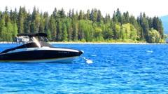 Sleek Black Speed Boat Anchored at Lake Tahoe Stock Footage