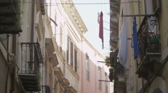 Row of apartments on a narrow Italian street. No people. Stock Footage