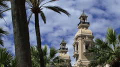 Palm tree framing the casino in Monaco Stock Footage