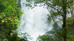 Water falls down from a great height. forest waterfall in thailand Stock Footage