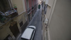 Car driving through narrow Italian street with rows of apartments. No people. Stock Footage