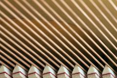 Snares of a piano in closeup Stock Photos