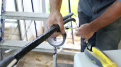 Worker connects wires by black electrical tape in apartment Stock Footage