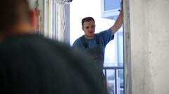 Workers set multi split system air-conditioning in apartment Stock Footage