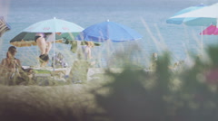 Group of people enjoying time at the beach in the summer Stock Footage