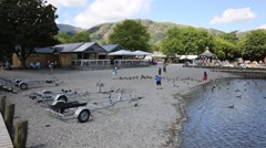 Coniston water Lake District England uk with ducks and tourists Stock Footage
