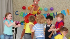 Kids catch soap bubbles, which lets entertainer at party Stock Footage