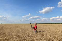 Stock Photo of agriculture, agronomist examine wheat field