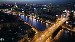 Moskva River and Building on Kotelnicheskaya Embankment at night Stock Footage