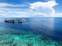 Boats at Dive Site in Sipadan Island, Sabah, Malaysia Kuvituskuvat