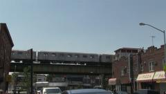 Subway train elevated slows to a stop Brooklyn Stock Footage