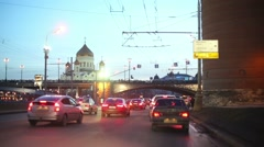 Cars slowly move in traffic jam on street. Stock Footage