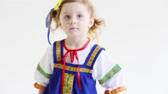 Little serious pretty girl in Russian folk costume poses Stock Footage