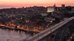 City Lights Come on as the Sun Goes down, Porto, Portugal Stock Footage