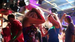 Nine young people have fun and dance at party in night club Stock Footage
