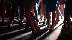 Slender legs young women have fun and dance at party Stock Footage
