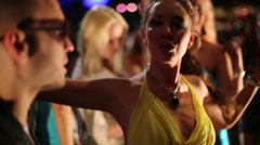 Seven people dance at night club. Guy with girl dance in front - stock footage