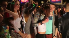 Eleven young people dance and have fun at night club Stock Footage
