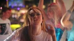 Eight men and women dance and have fun at modern night club - stock footage